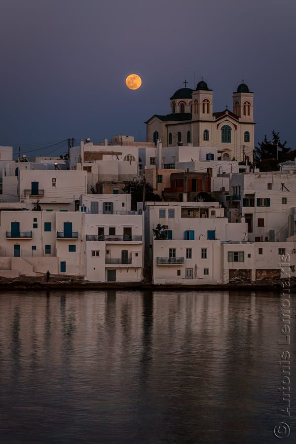 Full moon rise in Naousa, Paros island, Cyclades, Greece