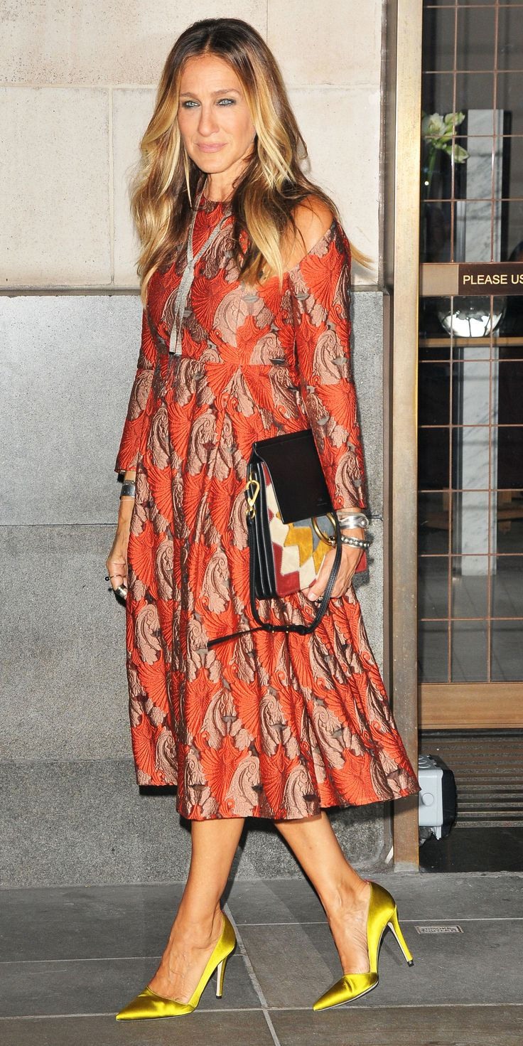 Sarah Jessica Parker celebrated the launch of her latest fragrance in a rich shoulder cut-out jacquard Emilia Wickstead dress, complete with satin chartreuse SJP pumps.