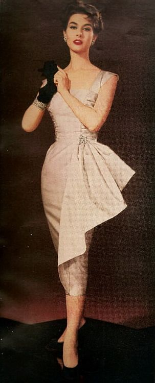 Inspiration: Pink Sheath Wiggle dress. 1955 50s pink wiggle dress with hip gather bustle bow color photo print ad model magazine