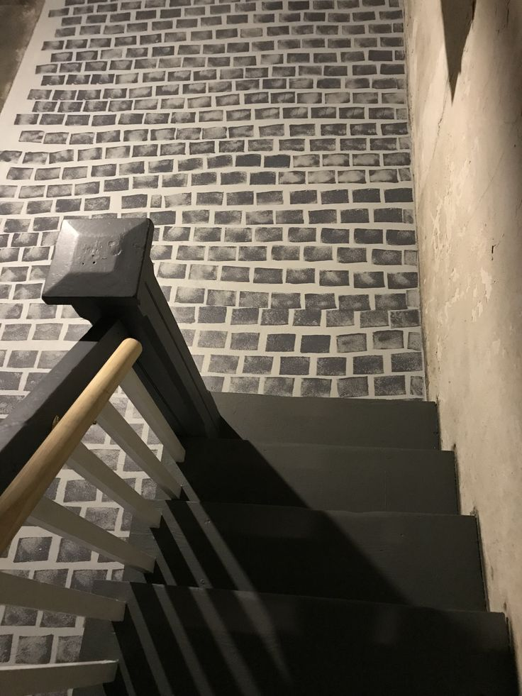 Painting basement floor and stair railings.   Cobblestones are supposed to be irregular