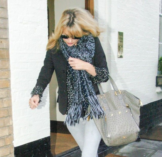 Kate-Moss with her Yves Saint Laurent Downtown Tote.$276+FREE ...
