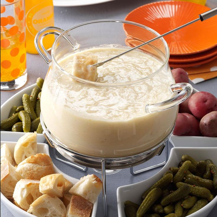 Three-Cheese Fondue Recipe -I got this easy recipe from my daughter, who lives in France. It's become my go-to fondue, and I make it often for our family.—Betty A. Mangas, Toledo, Ohio
