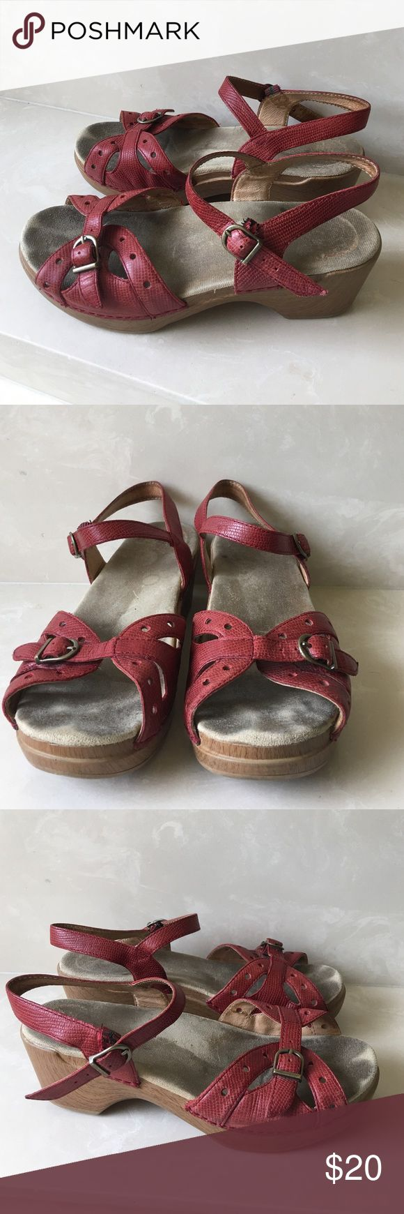 Authentic Dansko red leather sandals sz 39 US 8 Authentic Dansko red leather sandals sz 39 US 8 insoles are dirty and have marks and the elastic fasteners have some wear and will need to be reinforced. Sold as is final sale price listed please no offers Dansko Shoes Sandals