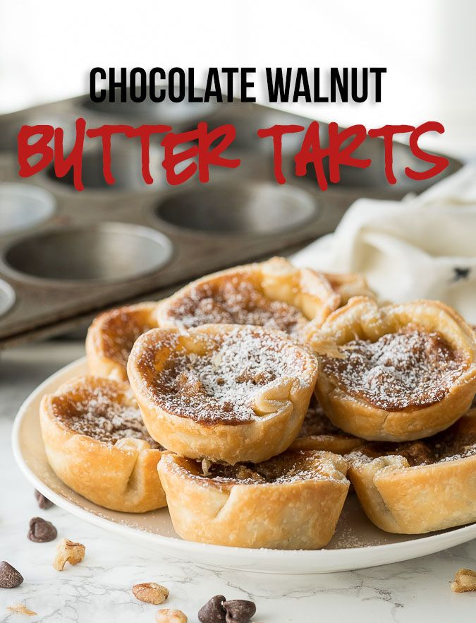 These delicious Chocolate Walnut Butter Tarts are filled with walnuts and chocolate in a gooey brown sugar mixture then topped with powdered sugar.