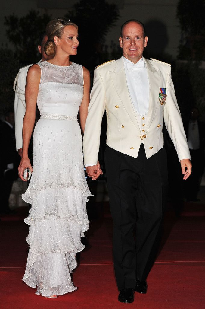 Prince Albert II and his new bride, Princess Charlene, arrive at the Palace de Monaco for their wedding reception.