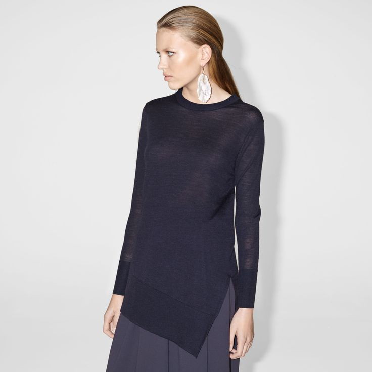 FWSS The Look Of Love is a thin, knitted sweater in a soft wool and cashmere mix with slit details and an asymmetrical hem.  http://fallwinterspringsummer.com/