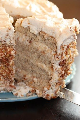 Banana Cake with Praline Filling and White Chocolate Ganache | The banana flavor was just right. The frosting was to die for! The cake is even delish straight out of the refrigerator!