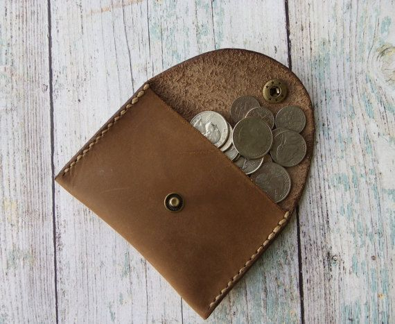 Leather Coin Purse - Change Purse - Coin Pouch - Made with Tan Leather - 100% Handcrafted Genuine Leather - Tan in color 100% Handcrafted and Hand Stitched with tan thread  The design of this coin pouch is ideal for those who prefer unconventional, elegant and functional design. It has one generous sized pocket and a durable snap closure. It can be easily kept in your pants pocket, jacket or in a bag.  Each coin pouch has its own distinctive pattern, resulting from the uniqueness of natural…