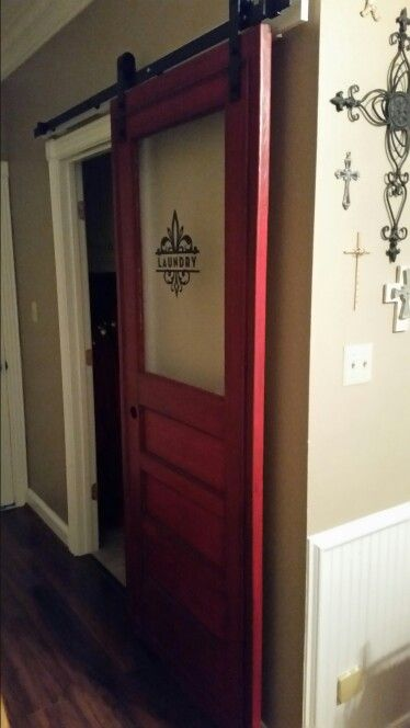 I repurposed the old back door from my parents' house into a laundry room door for my house. Painted with Annie Sloan Emporer's Silk Chalk Paint, dark glaze and then top coat. Mounted on a barn door slide rail. I love the way it turned out.
