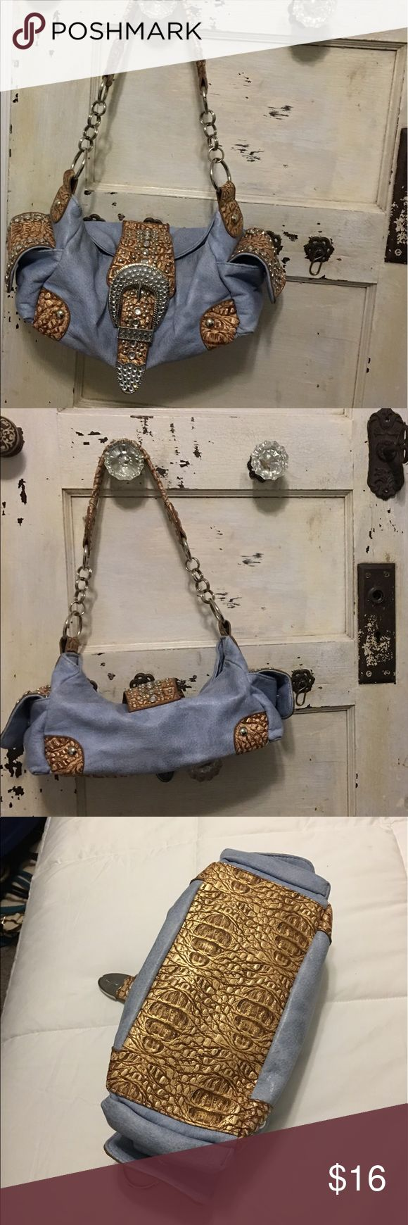 Adorable faux blue suede buckle studded purse Adorable faux blue suede purse with Rhinestone buckle and 2 studded side pockets. Excellent preowned condition💝💎 Bags Shoulder Bags