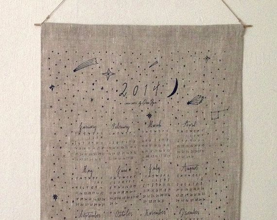A calendar adorned with shooting stars and crescent moons.