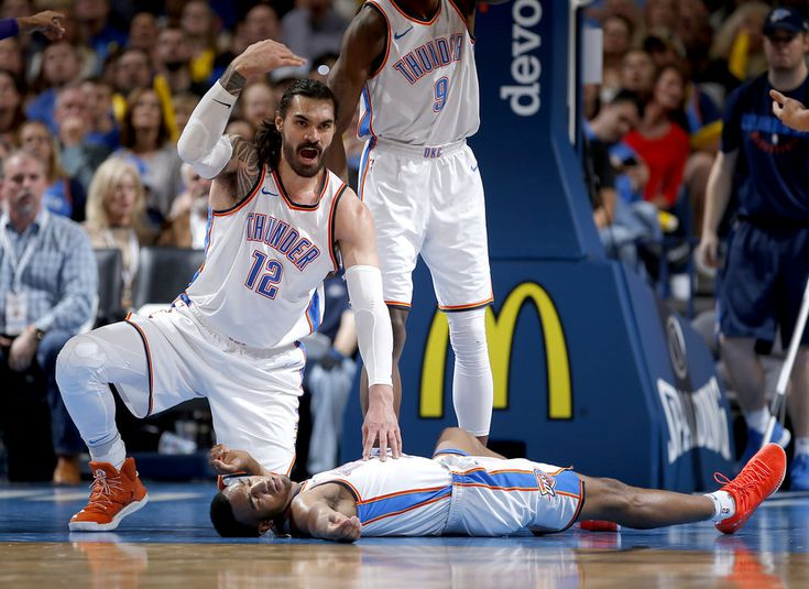 Oklahoma City's Steven Adams (12) calls for medical personal after Oklahoma City's Terrance Ferguson (23) took a hard fall during the NBA basketball game between the Oklahoma City Thunder and Phoenix Suns the Chesapeake Energy Arena, Thursday, March 8, 2018. Photo by Sarah Phipps, The Oklahoman
