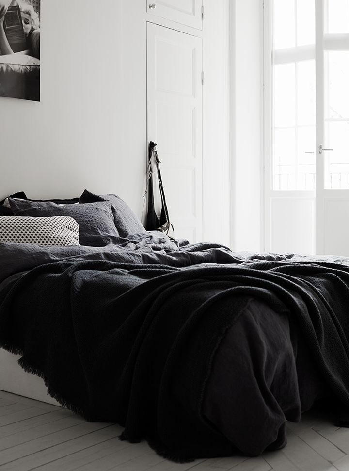 Charcoal bedding, bright walls.