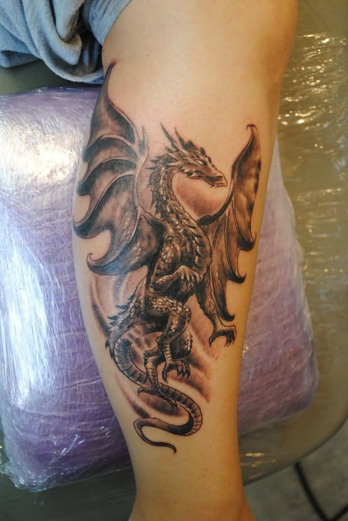 Black And Grey Gothic Dragon Tattoo On Leg Calf