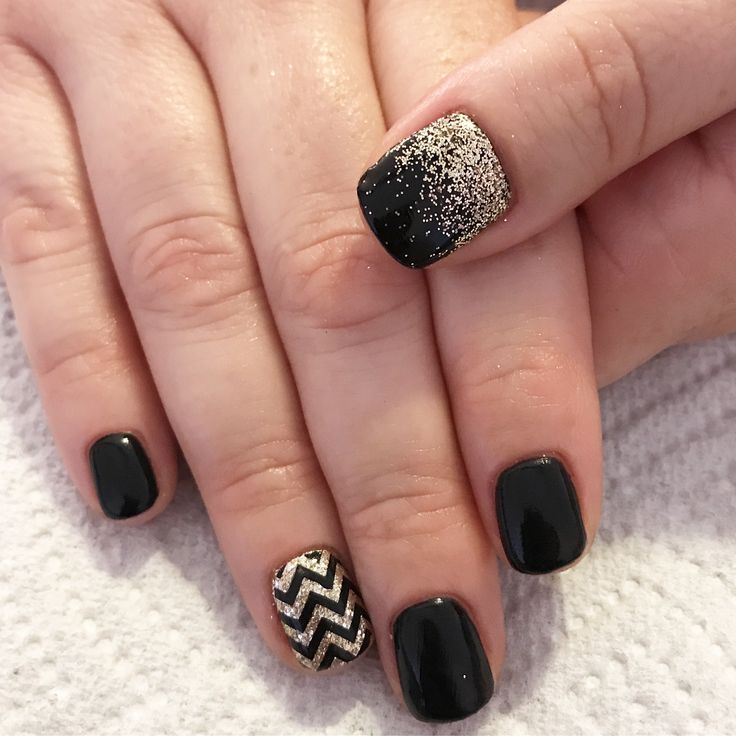 Black and gold gel nails. Black and gold nails. Gel nails. Glitter nails. Chevron nails. Nail art.