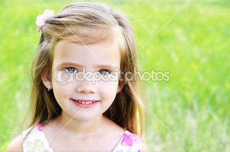 Cute smiling little girl on the meadow — Stock Image #26656753
