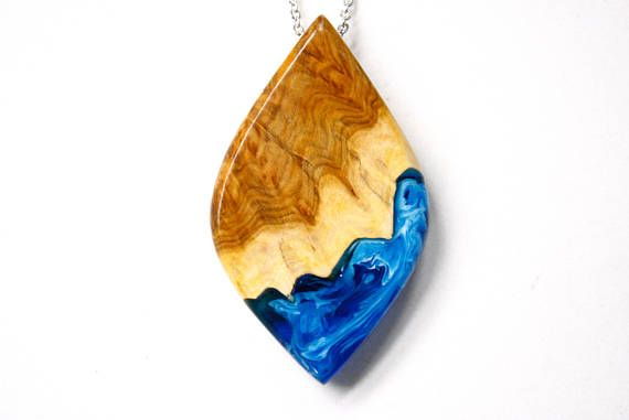Large eye shaped pendant / necklace handmade from Australian wood and a mixture of blue and white resin