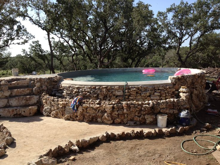 Stock pond pool with negative edge and waterfall landscape pinterest discover best ideas for Concrete stock tank swimming pool