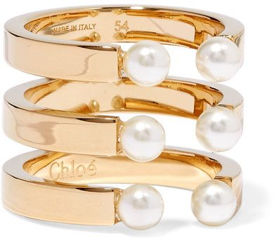 Chloé - Darcey Gold-plated Swarovski Pearl Ring  The #polished #gold - #plated brass setting of #Chloé #Darcey #ring is cleverly split to create a stacked effect. The trio of open bands are tipped with six  #Swarovski #pearls that gleam as they catch the light. Wear yours every day. #Chloé
