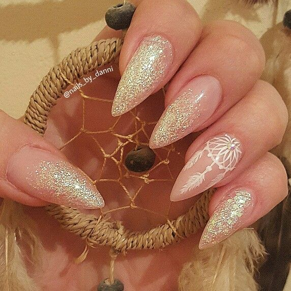 Acrylic short stiletto nails using NSI purely pink masque and some glitter. Handpainted dream catcher really finishes the look