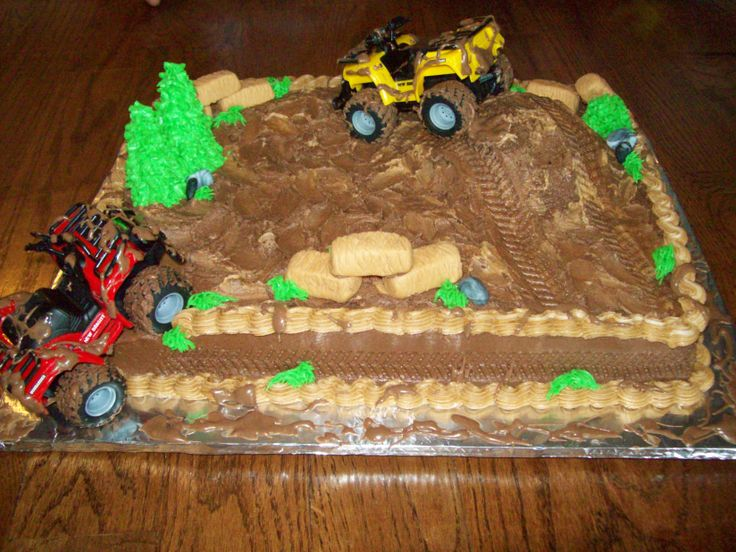 - This client wanted four wheelers and mud! I made a hill for the toy to drive up and put tracks in the butter cream. The trees are upside down sugar cone tips iced with butter cream. The hay bales and rocks are made of fondant