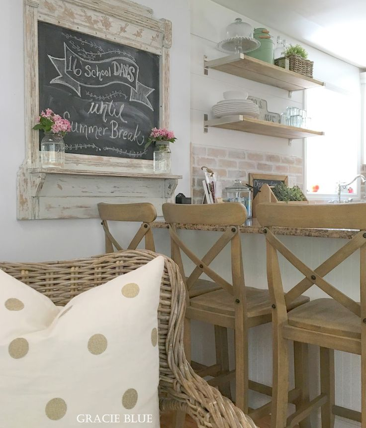Gracie Blue farmhouse kitchen. Cottage bar stools, chalkboard art.