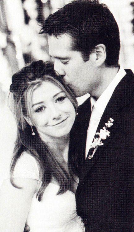 Alyson Hannigan & Alexis Denisof (October 11, 2003) Gown: Badgley Mischka | Location: Palm Springs, CA | Status: Married, 2 Children