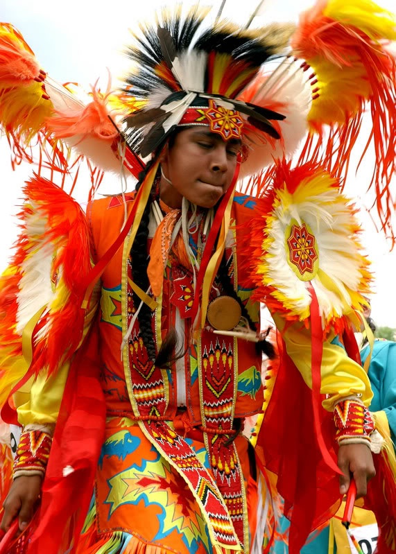 This photo shows a young man in Cherokee clothing mainly worn in