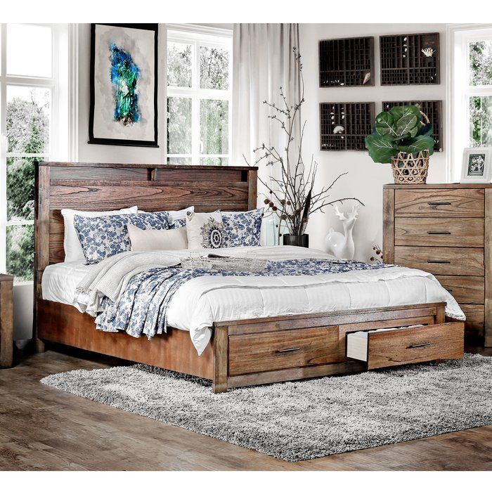 Equally at home in a rustic arrangement or downtown loft, this handsome bed showcases 2 storage drawers and a rich oak finish. Neatly and discreetly organize your belongings in a chic and stylish way thanks to the spacious design of the Transitional Style. A platform-style bed, this piece features a tall panel headboard with carved cut-out detailing and matching wooden side rails. The low profile footboard is readily equipped with a spacious two-drawer design featuring metal bar pull…