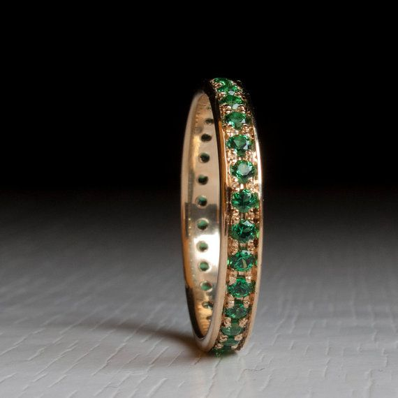 Emerald Eternity ring Enjoy The finest gemstones in the best setting in an affordable price. Meticulously handmade Emerald eternity ring.  Set Exclusively with Top Quality Emeralds. These Gem Stones are top notch and look exquisite under close inspection. Other stone requests and arrangements are welcome!  Stone count is subject to Ring size, For example a US 6.5 Ring will normally feature 26 stones. The ring width is: 2.5mm / 0.09 inches Stones are 1.5mm each.  All sizes available, Please…
