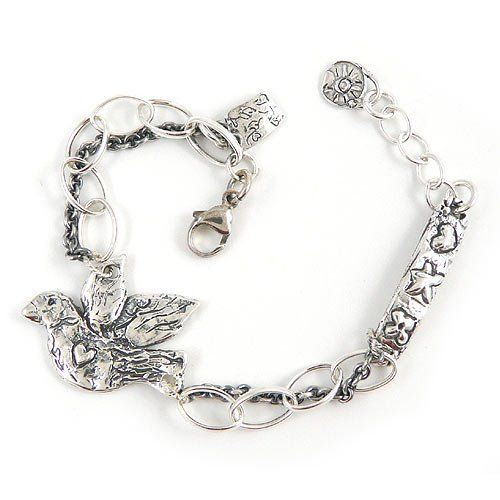 "Live True Sterling Silver Plated Double-Link Bracelet with Dove Island Cowgirl. Save 6 Off!. $99.99. Lobster-claw clasp, adjustable between 7 and 8 inches. Double strand of sterling silver plated chains accentuate a free spirited dove and dainty charms. Completely clated with 5x the normal amount of sterling silver to prevent wear and provide a higher quality standard!. Handcrafted in the USA. Dove is plated in sterling silver, the term ""Live True"" enthusiastically etched on the reverse"
