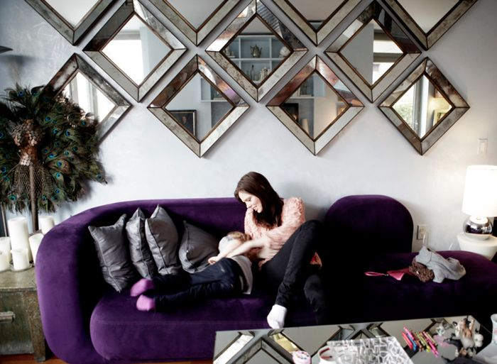 OH MY GOD. wall mirror collage, mirrored coffee table, violet couch, and grey throw pillows = my ideal living room.