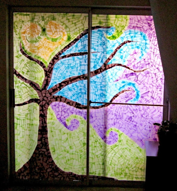 Modge podge & tissue paper window designs that are easily removable.