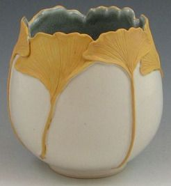 A Pratt Clay Studio ginkgo leaf vase. Completely hand-created with matte [yellow] glazed leaves and semi-matte white body. Full marked and dated and signed M. Pratt.