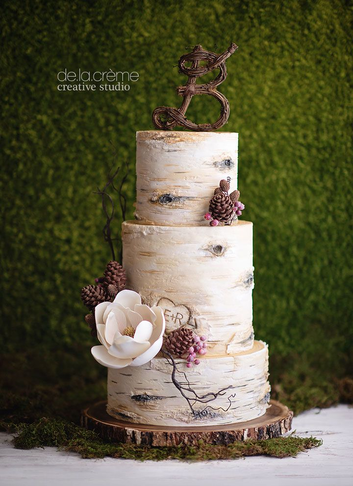 One of the most realistic birch tree wedding cakes we've ever seen!  Edible pinecones made from modeling chocolate and a magnolia sugar flower  ~ we ❤ this! moncheribridals.com