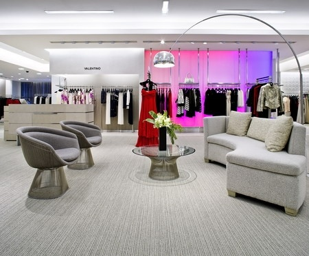Saks Fifth Avenue, Mexico City. The colors are grey and boring, until your eye reaches the bright saturated colored display to the back right. This color brings your eye to the red dress in the middle of the store. Using the neutral grey in most of the store with an accent of light can help a merchandiser train their customer to look exactly where they want them to look.