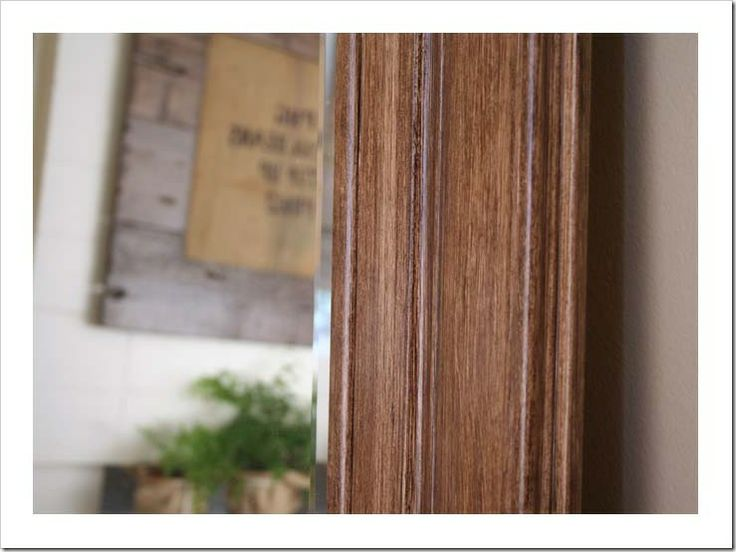 """Faux wood: """"First I primed the plastic black frame with Kilz primer, then I applied one coat of Behr's Seaside Sand paint. Once dry, I applied Varathane premium gel stain in Dark Walnut, purchased at Home Depot. When you apply this stain over a white painted surface, you get a great grain effect, much like wood."""""""