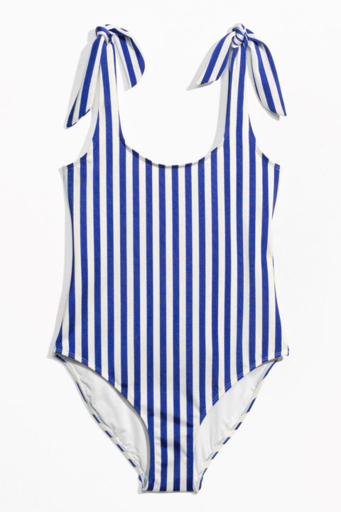 Sweet summer stripes of this & Other Stories one piece are perfect for Instagram worthy pool shots.