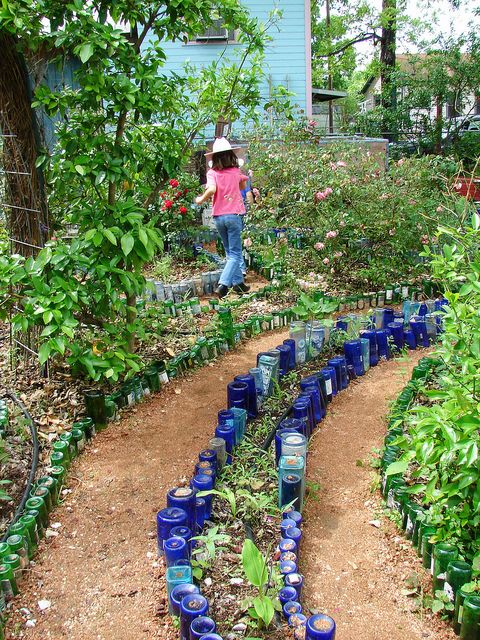 recycled wine and water bottle garden path blue & green bottles create a labyrinth path in the garden; add color and direction; Upcycle, Recycle, Salvage, diy, thrift, flea, repurpose! For vintage ideas and goods shop at Estate ReSale & ReDesign, Bonita Springs, FL