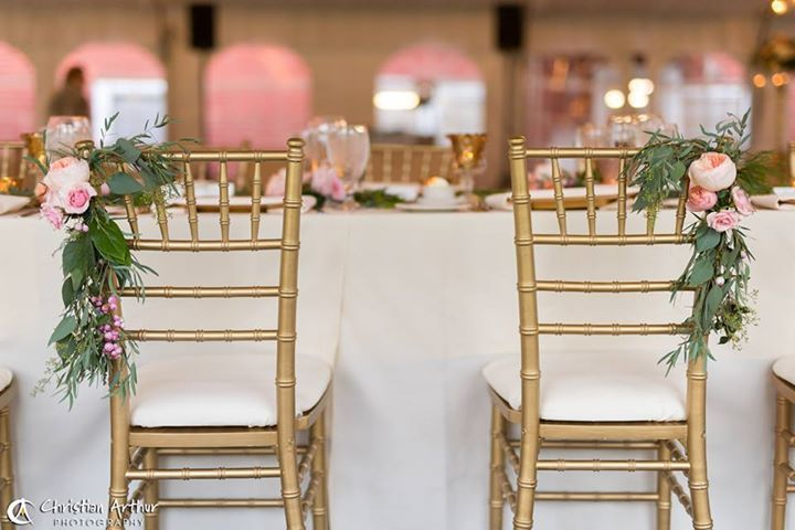 Gold chiavari chairs truly tied the look of the wedding together.