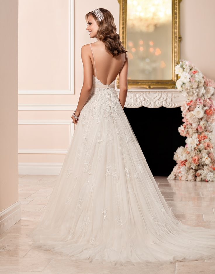 6347 // This lace and tulle A-line wedding dress by designer Stella York features a low v-neck bust and back, spaghetti straps, and Diamante beading throughout.
