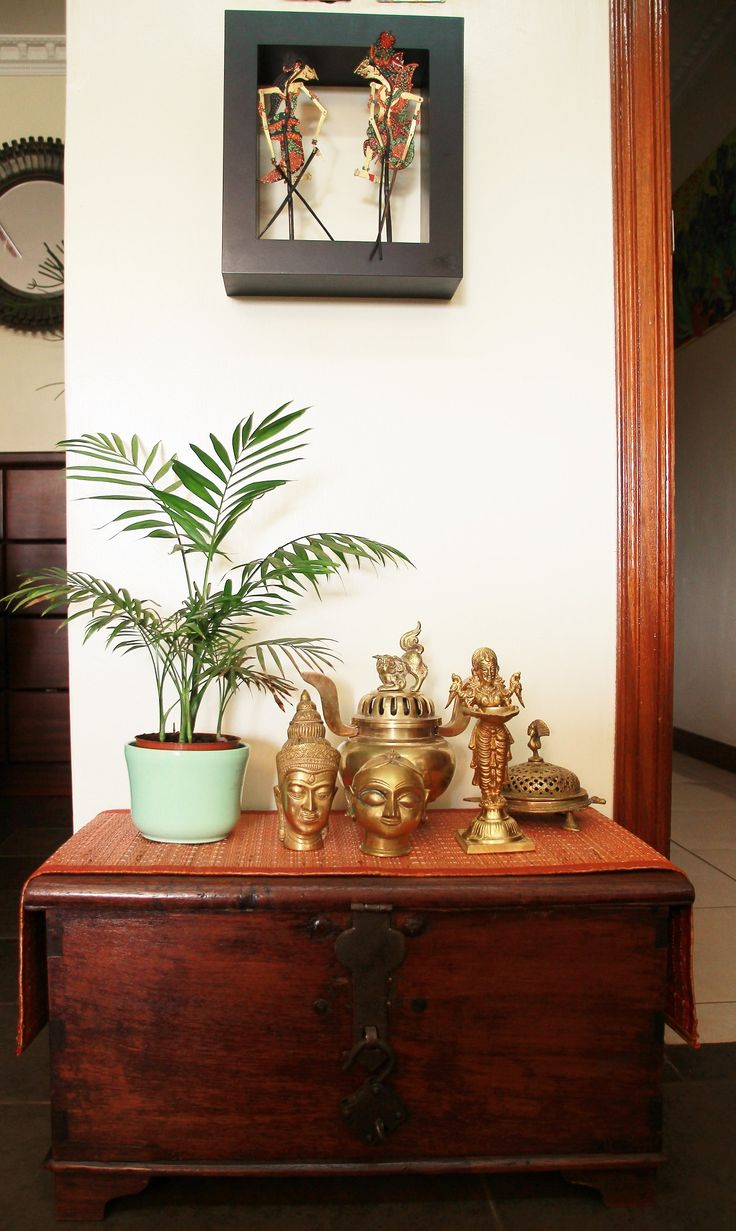 My brass collection with Indonesian leather puppets!! Brass lamps, Shiva Parvati. Indian home decor