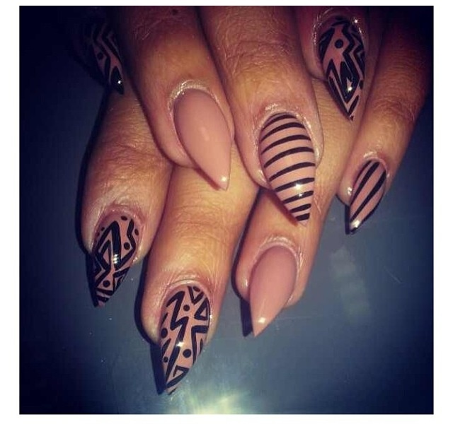 I'm not a big fan of the whole pointy nail fad, however I do think this is cute