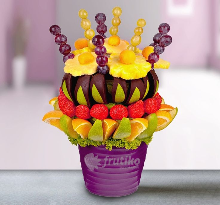 Fruit dream from pineapple, strawberries, apples, oranges and grapes