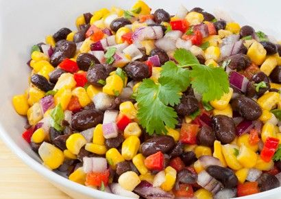 1 cup whole-kernel corn 2 cans (16 ounces each) black beans, rinsed and drained 1/4 cup chopped fresh parsley 2 tablespoons minced red onions 1/4 cup balsamic vinegar 2 tablespoons olive oil 1 teaspoon lemon juice 1 teaspoon minced garlic 1 teaspoon honey or brown sugar salt ground black pepper lettuce leaves