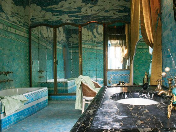 Art deco bathroom of fern lombard bedaux blue glass mosaics cover the walls and