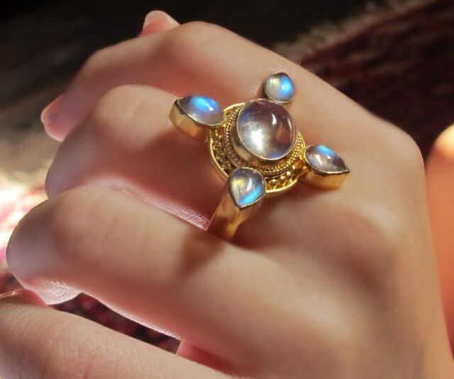 GR 62: Solid 22 Kt Gold Mounting Inspired by Buddhist and Hindu Symbols, and Studded With Sri Lankan Moonstones. The Central Stone is Oval and Cabochon Cut. The 4 directions are Marked by Pear Shaped Cabochons. Totally Mystical my Dear.