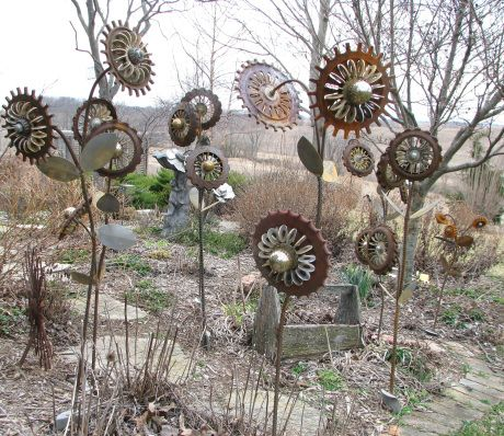 Rusty Flower Garden - Made out of welding corn planter plates, wind turbine ball bearings, flat washers, electrical box knockouts, screen door parts and rebar. From: Don's Daylily Divider