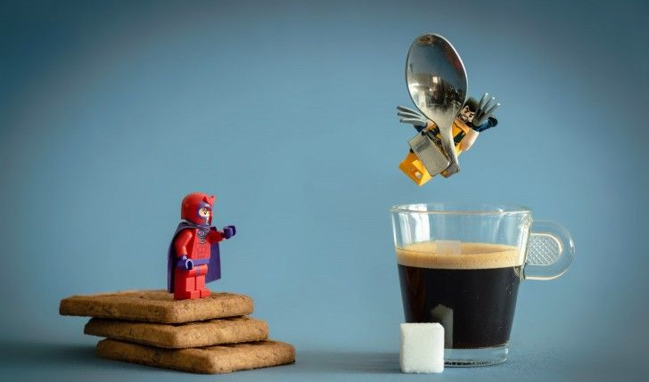 LEGO Magneto wraps Wolverine in a large metalic spoon