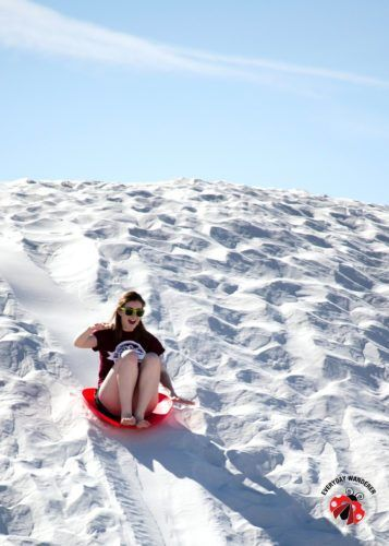 Sledding is a fun activity at White Sands National Monument
